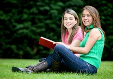 Females reading outdoors Stock Image