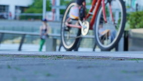 Females riding bicycles urban lifestyle stock footage