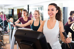 Females riding cardiovascular trainers Royalty Free Stock Photos
