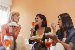 Females Socializing At Home. Female Friends Eating Delicious Dessert And Socializing At Home Stock Photography