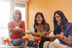 Females Socializing At Home. Female Friends Eating Delicious Dessert And Socializing At Home Stock Images