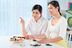 Females talking by dinner Royalty Free Stock Photos