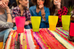Females tasting drink at home Royalty Free Stock Image
