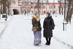 Females in winter clothes talking Stock Photo