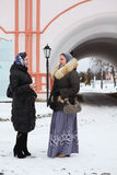 Females in winter clothes talking Stock Images