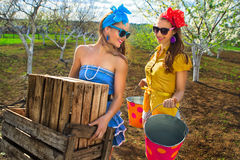 Females with wooden box and buckets Stock Photo