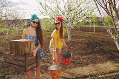 Females with wooden box and buckets Royalty Free Stock Photography
