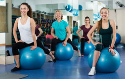 Females working out with aerobic ball. In a modern gym Royalty Free Stock Photos