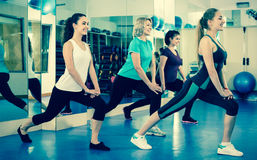 Females working out at aerobic class in modern gym. Smiling females working out at aerobic class in modern gym for women Stock Photo