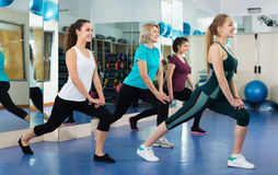 Females working out at aerobic class in modern gym Stock Photo