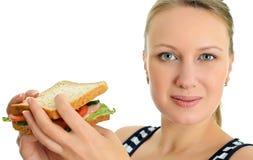 Femelle attirante avec le sandwich Photos stock
