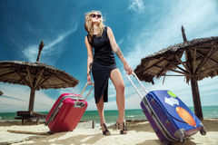 Femelle avec valises Photographie stock