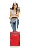 Femelle dans la position occasionnelle avec la valise de voyage photographie stock
