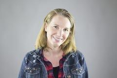 Femelle de sourire dans la veste 2 Photos libres de droits