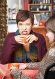 Femelle fâché ayant le café Image stock