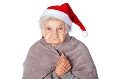 Femelle pluse âgé avec le chapeau et la couverture de Santa Claus Photos libres de droits
