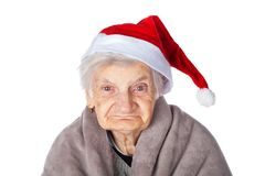 Femelle pluse âgé avec le chapeau et la couverture de Santa Claus Photographie stock