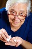 Femelle supérieure avec des pilules Images libres de droits
