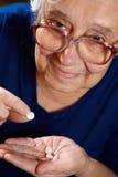 Femelle supérieure avec des pilules Photos stock