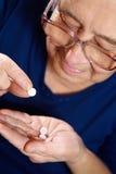 Femelle supérieure avec des pilules Image stock