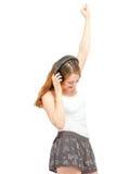 Femenino divirtiéndose que escucha los auriculares Fotografía de archivo libre de regalías