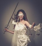 Femida, Goddess of Justice. With scales and sword wearing blindfold Stock Image