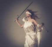 Femida, Goddess of Justice. With scales and sword wearing blindfold Royalty Free Stock Photo