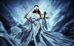 Femida, Goddess of Justice. With scales and sword wearing blindfold against dramatic stormy sky Royalty Free Stock Photography
