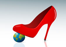 Femine authority concept. With red shoe and small globe Royalty Free Stock Images