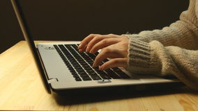 Femine hands typing on the keyboard of a laptop stock video footage