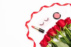 Valentine`s day or date background. Feminine backdround with cosmetics and red roses. Valentine`s Day, holiday, event or going on a romantic date concept royalty free stock photography