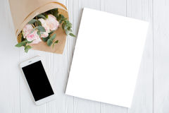 Feminine background with smartphote, roses and magazine cover mo Royalty Free Stock Image