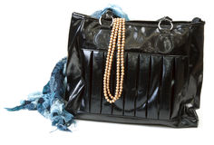 Feminine Bag With Scarf And Necklace Royalty Free Stock Photo