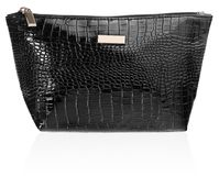 Feminine beautician to store cosmetics. Purse for women made of. Women`s beautician to store cosmetics. Purse for women made of black imitation leather with Stock Images