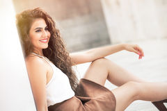 Feminine beauty. Curly hair young smiling woman model. Royalty Free Stock Photography