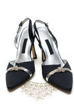 Feminine black loafers and necklace Royalty Free Stock Image