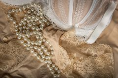 Feminine bra, perlas and underclothes Stock Image
