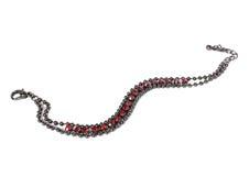 Feminine bracelet with red gems Stock Images