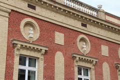 Feminine busts decorate the facade of a brick house situated in Deauville (France) Royalty Free Stock Image