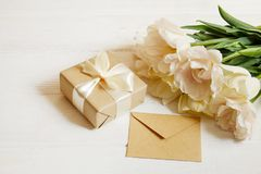 Beautiful spring holidays flowers arrangment. Bunch of white tulips in festive composition, copy space for text, white background. Feminine composition with Royalty Free Stock Photo