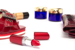 Feminine cosmetic background. Essentials of a modern woman in re Stock Photography