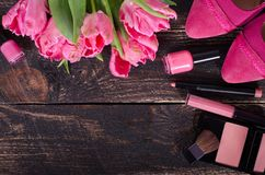 Feminine cosmetic background. Overhead of essentials of a modern woman. Free space for your text.  Stock Photography