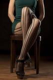 Feminine crossed legs Royalty Free Stock Image