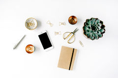 Feminine desk workspace. With succulent, phone, scissors, diary and golden clips on white background. flat lay, top view Stock Photo