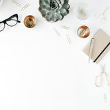 Feminine desk workspace with succulent, scissors, diary, glasses and golden clips on white background Stock Images