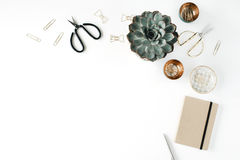 Feminine desk workspace with succulent, scissors, diary and golden clips on white background. Flat lay, top view royalty free stock photo
