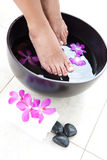 Feminine feet in foot spa bowl Stock Photography