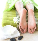 Feminine feet in spa setting with orchid Stock Image