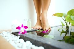 feminine feet by a sunken foot bath