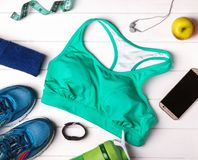 Feminine fitness outfit. On the white background, top view Royalty Free Stock Photography